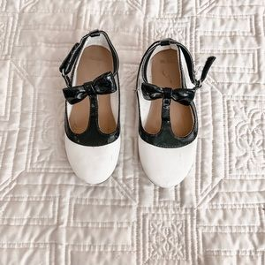 White and black t strap flats